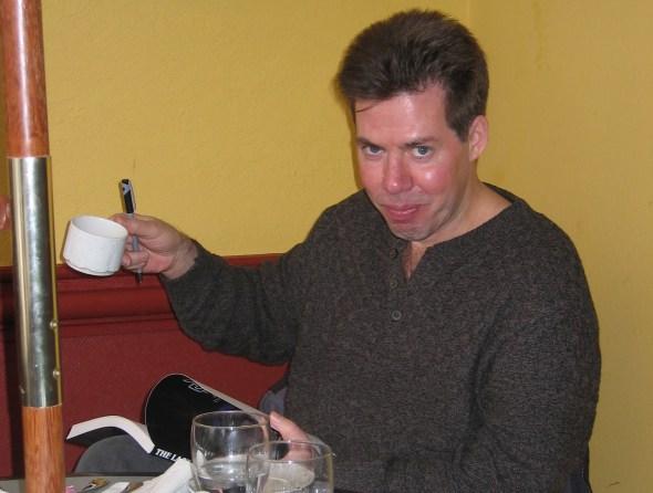 A Man Wearing A Grey Shirt