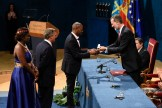 Amref Health Africa Group CEO Dr Githinji Gitahi receives the Princess of Asturias Awarrds for International Cooperation from the King of Spain, Felipe VI at the award ceremony in Oviedo, Spain