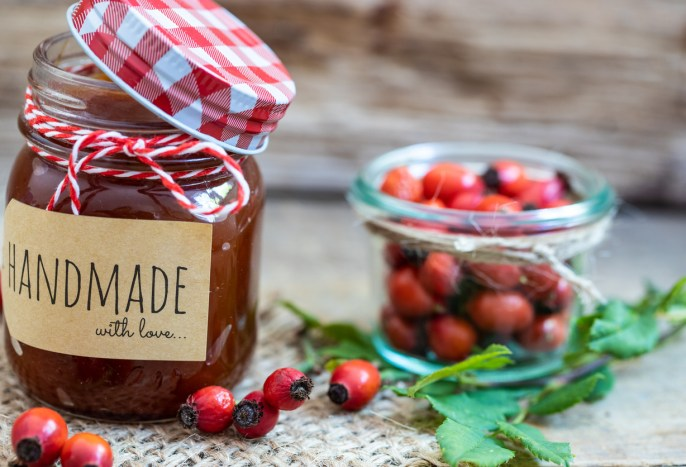 handmade marmalade from rose hips and a glass of rose hips