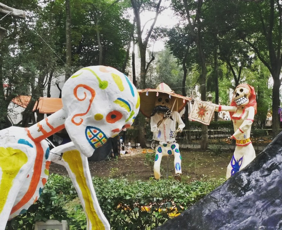 Day of the dead, skeletons decorate a park in Mexico