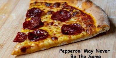 pizza slice with plant-based pepperoni