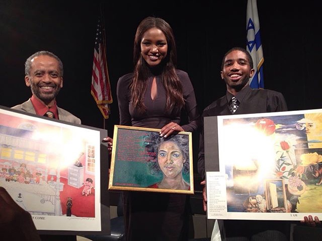 L-R) Jerome Jones; first Black Miss Israel, Yityish Aynaw; and Jeromyah Jones. Aynaw holds Jeromyah's painting of her that she autographed. (301783)