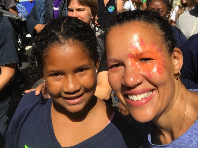 New York Amsterdam News Publisher and Editor in Chief Elinor Tatum and her daughter Willa at a climate change march in 2019. (307926)
