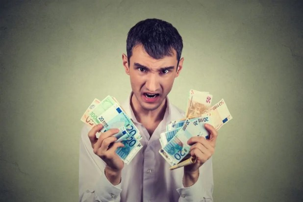 greedy landlord holding euros taken from an expats rental security deposit