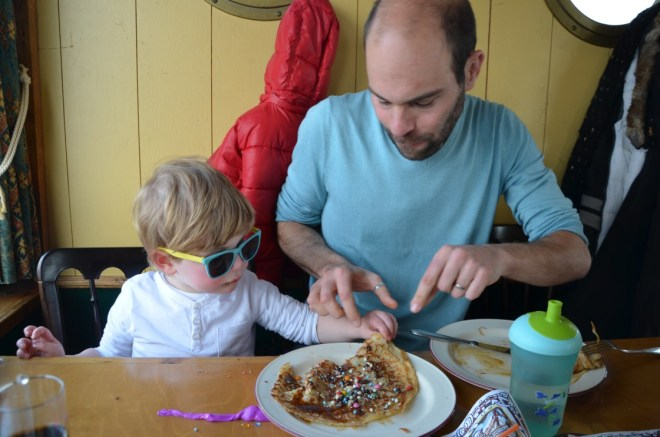 Toddler and father enjoying pancakes on the Pancake Boat Amsterdam (Pannenkoekenboot)
