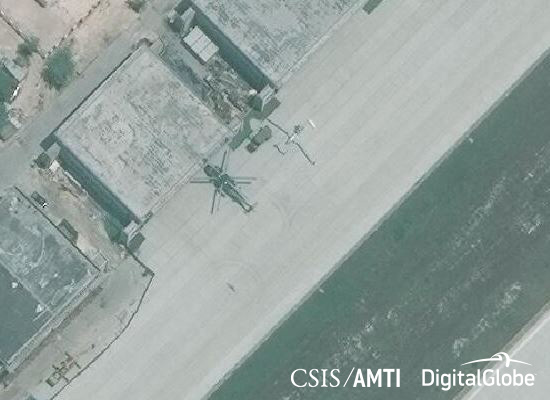 A helicopter believed to be a Harbin Z-8 and a drone believed to be a Harbin BZK-005 in front of hangars on Woody Island, April 26, 2016.