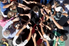 Celebrity Engulfed by Fans on Red Carpet