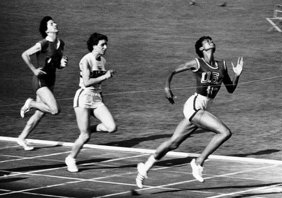 Wilma Rudolph wins the 100 meter dash at the 1960 Summer Olympics