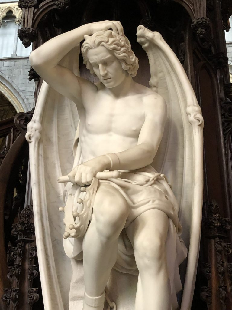 """The sculpture """"La Genie du Mal"""" by Guillaume Geefs seen in St. Paul's Cathedral in Liege, Belgium."""