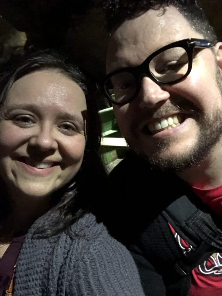 A selfie of Amy and Chris on a boat in a cave in Belgium.