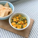 mango salsa in a bowl with chips