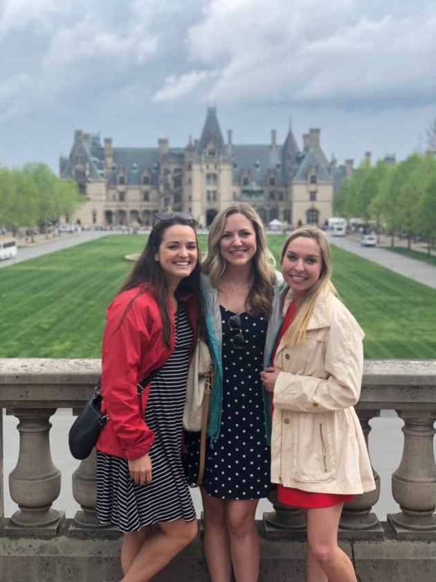 three girls standing in front of the biltmore