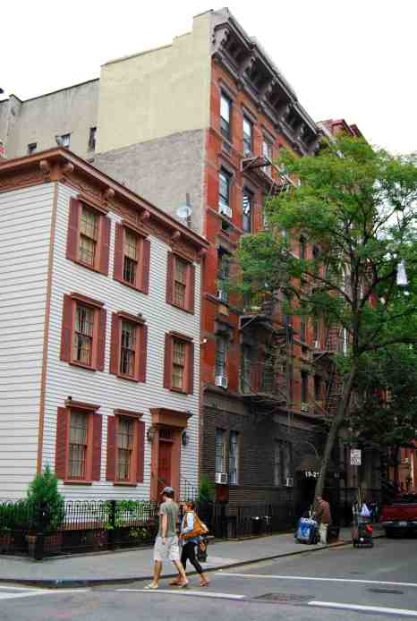 Last wooden house in the West Village on the left; Ross from Friends apartment block on the right