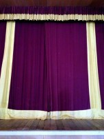 The curtains behind which many a star has stood.