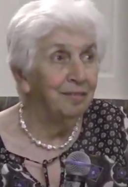 white haired woman smiling - Lamia Al Gailani Werr