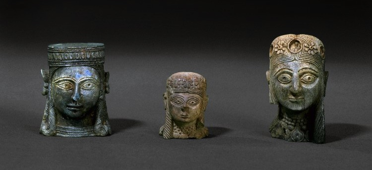 Three small sculptures of female heads