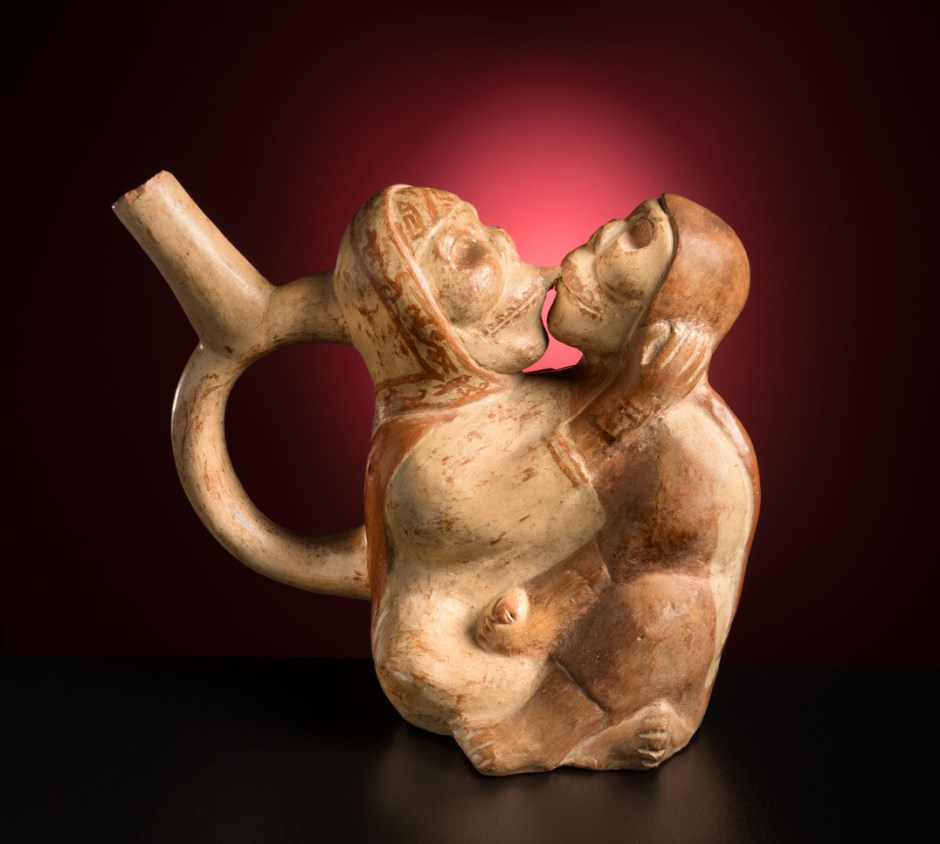 sculpture of two figures hugging and kissing - Moche