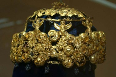 gold crown of flowers and female figurines