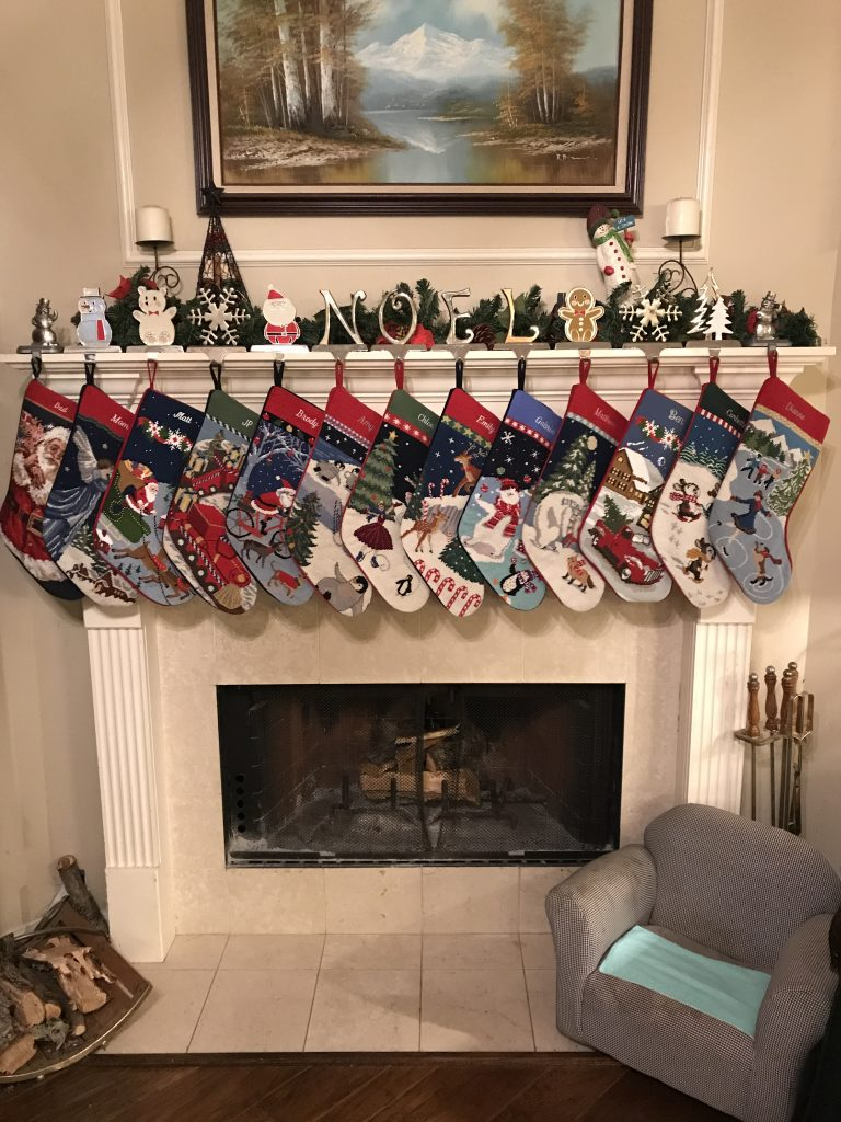 Family stockings hung on a fireplace.