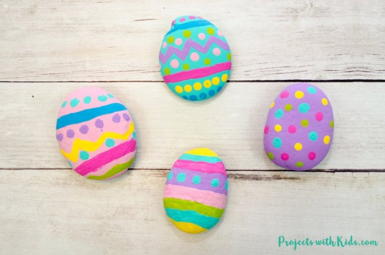 Painted rock Easter eggs. A fun Easter themed craft that they whole family can enjoy.