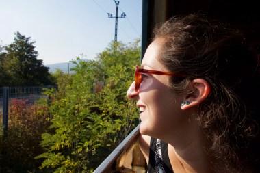 Sam enjoys sun on a little train that took us through the town/museum
