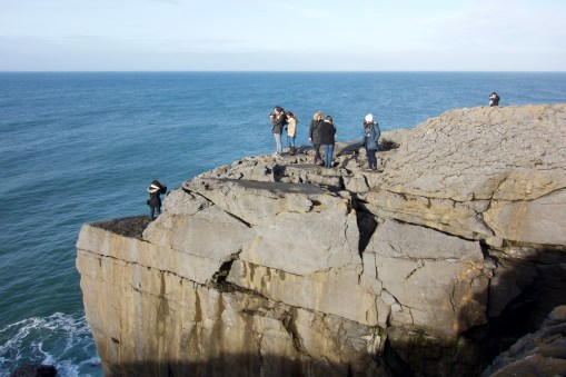 A tourist (me) taking photos of other tourists at the mini cliffs