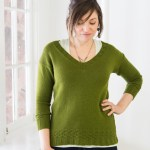 Green v-neck drop shoulder sweater, worn close fitting