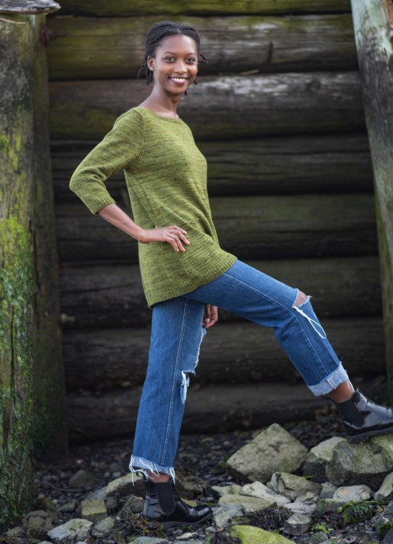 The same woman as above, now showing the roomy fit of the pullover from the side.