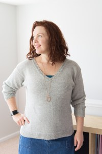 The author in a drop-shoulder sweater that has a close fit through the shoulders, and barely-skimming fit through the body.