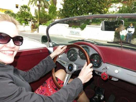 blonde woman driving vintage 1956 Porsche 356 Speedster convertible