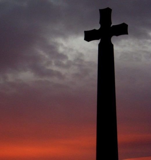 A cross in Durham silhouetted by the sunset.