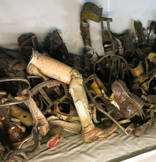 pile of prosthetics from Holocaust victims at Auschwitz
