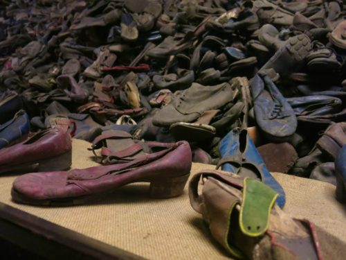 A display case full of shoes that belonged to Holocaust victims at Auschwitz.