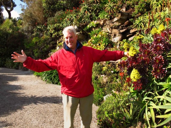 Mike Nelhams, curator of Tresco Abbey Gardens on England's Isles of Scilly, poses among the foliage.