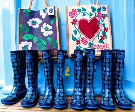 Wellies lined up with beach bags at Seasalt, a shop on St. Mary's, England's Isles of Scilly