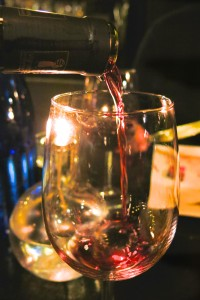 close-up of red wine poured from a bottle into a glass at Proeverij 274 in Amsterdam
