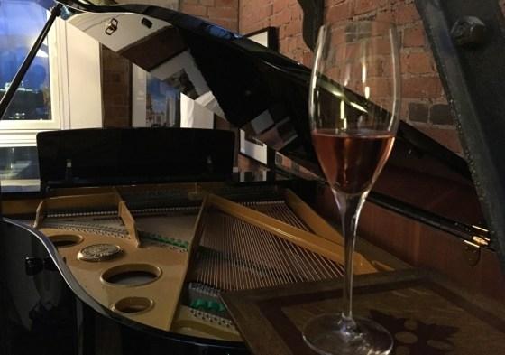wine glass on grand piano