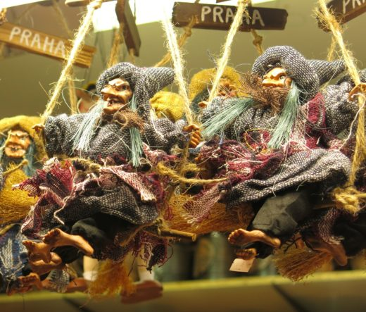 doll witches on broomsticks at a market in Prague