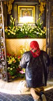 A woman prays before a portrait of the Virgin Mary at Stone Gate in Zagreb.