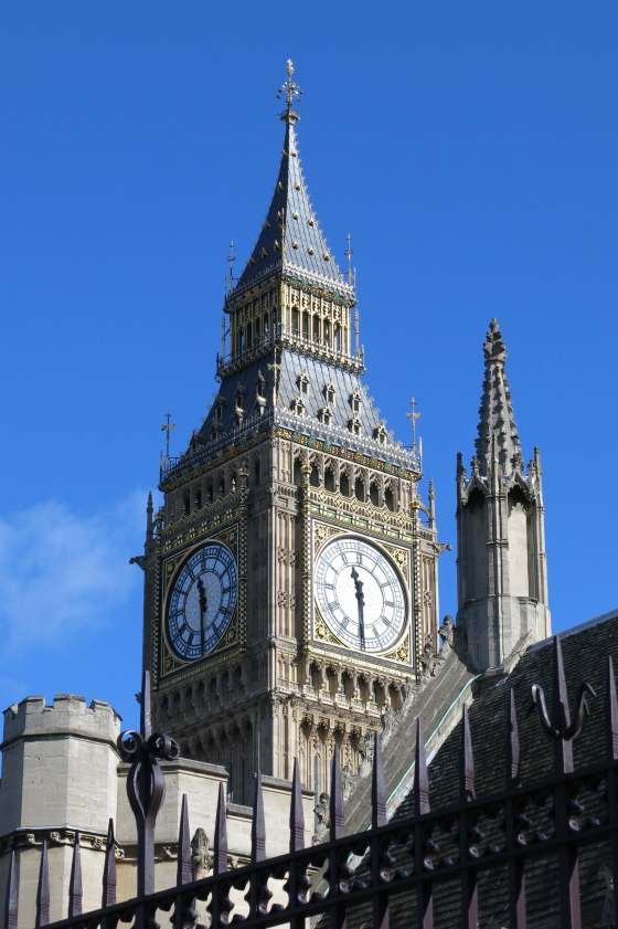 Big Ben, officially known as Elizabeth Tower, punctuates a clear blue sky in London