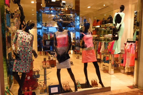 mannequins in colorful dresses in a window of a posh shop in Portals Nous, Calvia, Mallorca