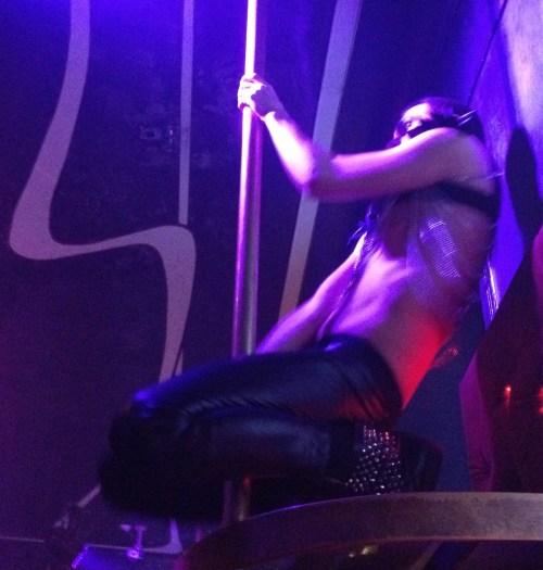 Leather-clad pole dancer at Club Prive in Tallinn, Estonia