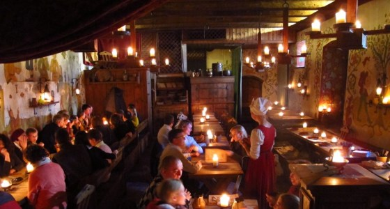 Waiters and waitresses in medieval attire serve hearty meals and ceramic mugs of honey beer at Olde Hansa restaurant in Tallinn's Old Town. Copyright Amy Laughinghouse.