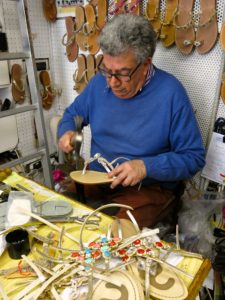 Toni Corcione of Sandali Coercion in Sorrento works on a pair of handmade sandals