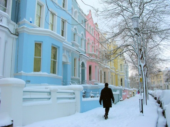 Snow coats the sherbet colored houses of Notting Hill.
