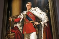 """A portrait of Queen Helena's late King Simon hangs in the Great Hall of """"The Royals"""" set."""