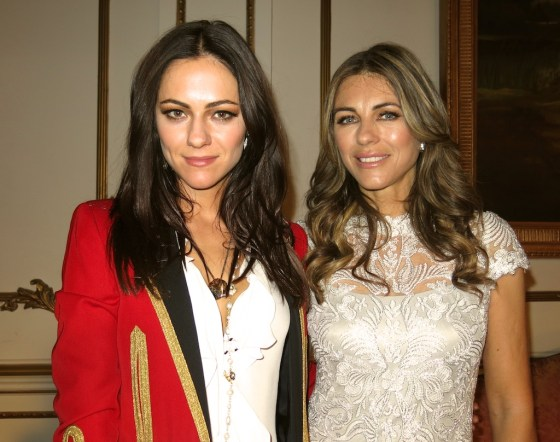 Alexandra Park and Elizabeth Hurley of The Royals E! television series, on set in London