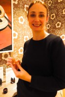 Perfumier Nicola Barron holds a bottle of perfume
