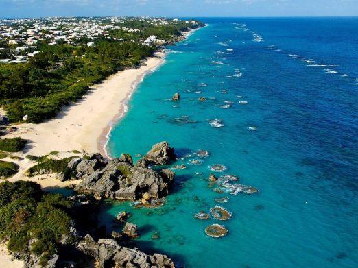 Clear teal-blue waters lap at Bermuda's coastline. Courtesy Bermuda Tourism.