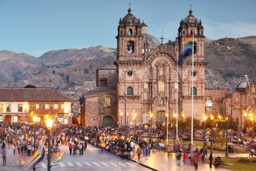 A crowd gathers in front of the Church of the Society of Jesus in Cusco, Peru. Courtesy Richard James Taylor/Belmond.